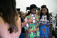 MILAN, ITALY - SEPTEMBER 23: Ogbewi Imade, (c) a Nigerian model waits backstage before a show with the Italian Haitian designer Stella Jean at Milan Fashion Week Spring/Summer Milan 2016, in Milan, Italy.  (Photo by: Per-Anders Pettersson)