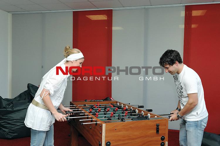 Portrait Timo Glock - Privat  - <br /> <br /> In siener Freizeit spielt Timo Glock gerne Tischfussball / Kickerfussball hier mit seiner 23 jaehrigen Freundin Isabell, die sich ueber ein Tor freunen durfte<br /> <br /> Foto: &copy; nph ( nordphoto )