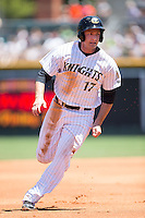Jason Coats (17) of the Charlotte Knights hustles towards third base against the Indianapolis Indians at BB&T BallPark on June 21, 2015 in Charlotte, North Carolina.  The Knights defeated the Indians 13-1.  (Brian Westerholt/Four Seam Images)