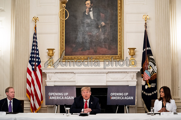 From left to right: Brad Smith, President, Microsoft; United States President Donald J. Trump; and Sonia Syngal, CEO, Gap Inc. during a roundtable discussion with industry leaders on reopening the American economy in the State Dining Room of the White House in Washington, DC on May 29, 2020. <br /> Credit: Erin Schaff / Pool via CNP/AdMedia