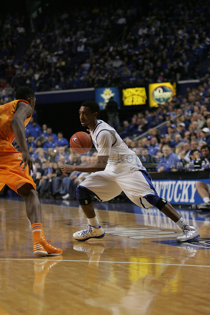 Sophomore Guard Ryan Harrow (12) initiates a play during the University of Kentucky vs Tennessee Men's Basketball game in Lexington, Ky., on, January 15, 2013. Photo by Jared Glover | Staff