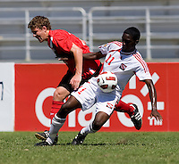 Samuel Piette (2) of Canada is called for the foul of Garvin Samaroo (11) of Trinidad & Tobago during the quarterfinals of the CONCACAF Men's Under 17 Championship at Catherine Hall Stadium in Montego Bay, Jamaica. Canada defeated Trinidad & Tobago, 2-0.