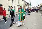 Jamie Williams, World Tae Kwon Do winner and St Patrick, aka Michael Corbett, lead out the St Patrick's Day parade in Sixmilebridge. Photograph by John Kelly.