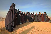 Tuareg women sing and dance at sunset in Mali Sahara desert