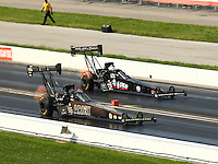 Sep 5, 2016; Clermont, IN, USA; NHRA top fuel driver Tony Schumacher (near) races alongside Tripp Tatum during the US Nationals at Lucas Oil Raceway. Mandatory Credit: Mark J. Rebilas-USA TODAY Sports