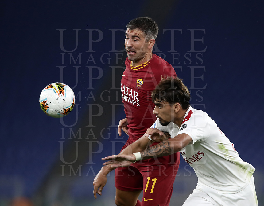 Football, Serie A: AS Roma - AC Milan, Olympic stadium, Rome, October 27, 2019. <br /> Roma's Aleksandar Kolarov (l) in action with Milan's Lucas Paqueta (r) during the Italian Serie A football match between Roma and Milan at Olympic stadium in Rome, on October 27, 2019. <br /> UPDATE IMAGES PRESS/Isabella Bonotto