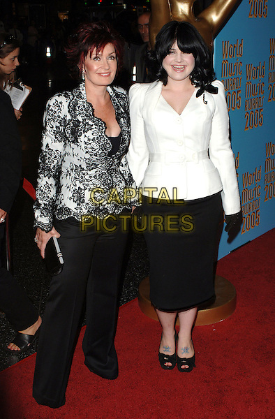 SHARON OSBOURNE & KELLY OSBOURNE.2005 World Music Awards, held at the Kodak Theatre, Hollywood, CA..31st August 2005.full length black and white floral print jacket mother daughter family black trousers white jacket gloves skirt.www.capitalpictures.com.sales@capitalpictures.com.©Capital Pictures.