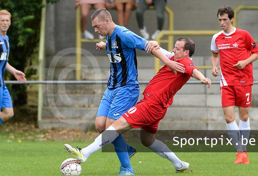 Daring Ruddervoorde - FC Veldegem : Dennie Damman (r) met de tackle op Nils Vanderheydt (links)<br /> Foto David Catry | VDB | Bart Vandenbroucke