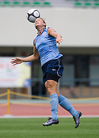 USWNT forward Abby Wambach tries to keep a rising ball under control during practice at Anyang Sports Center in Seoul, South Korea.