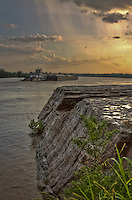 A tugboat pushing a barge up the Arkansas River after a rain storm at Wilson Rock, near Muldrow Oklahoma.