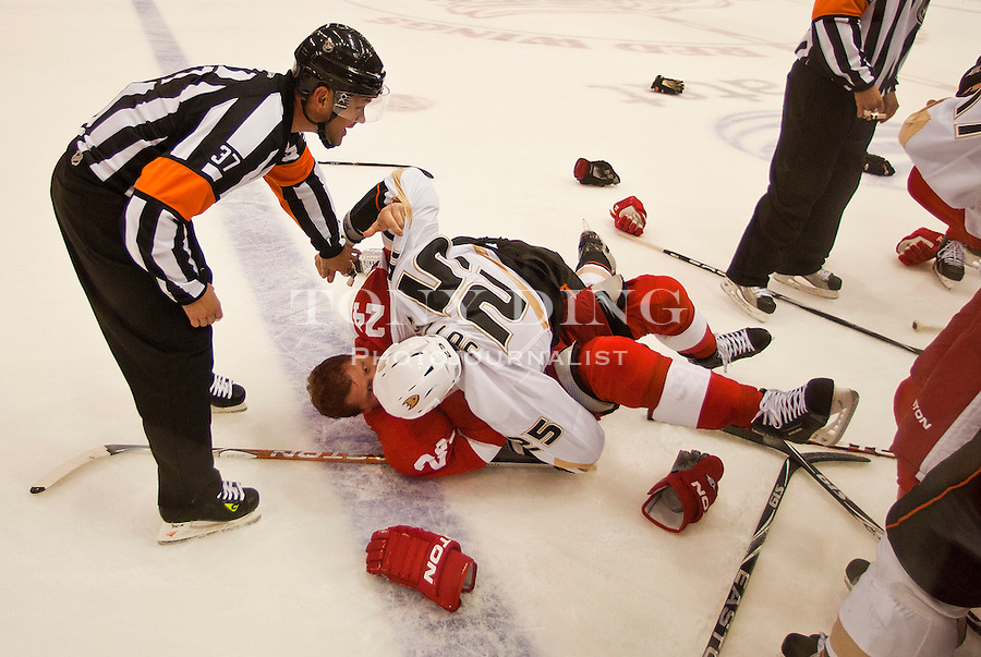 8 October 2010: Referee Kyle Rehman (37) attempts to break up a fight between Detroit Red Wings defenseman Ruslan Salei (24) and Anaheim Ducks defenseman Andy Sutton (25), in the second period of the Anaheim Ducks at Detroit Red Wings NHL hockey game, at Joe Louis Arena, in Detroit, MI...***** Editorial Use Only *****