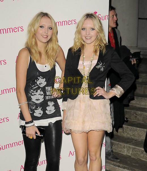 SAMANTHA & AMANDA MARCHANT.The Ann Summers Enchantment Collection launch party, The Baccarat Room, 1 Marylebone Rd., London, England..December 1st, 2008.anne half 3/4 length black dress white cream sheer chiffon jacket necklaces hand on hip tank top leggings layers layered punk rock 1979 tour clutch bag twins sisters siblings sam samanda .CAP/CAN.©Can Nguyen/Capital Pictures.