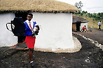 NGUDWINI, SOUTH AFRICA - SEPTEMBER 10: Nobule Ngema, age 16, gathers her traditional clothing as she's preparing to travel to the annual Reed Dance on September 10, 2004 in Ngudwini village in rural Natal, South Africa. Nobuhle is traveling on a bus and about 20.000 fellow maidens from all over South Africa is coming to dance for Zulu King Goodwill Zwelethini at the Enyokeni Royal Palace in Kwa-Nongoma about 350 kilometers from Durban. The girls come to the kingdom to declare their virginity and the ceremony encourages girls and young women to abstain from sexual activity to curb the spread of HIV-Aids. Its Nobuhle's first trip and she's already has three virginity certificates, as she was tested in the village for the last three years. .(Photo: Per-Anders Pettersson)......