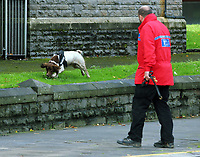 Pictured: A search police officer with a sniffer dog outside St Mary's church in Princess Street, Swansea. Friday 15 September 2017<br /> Re: Soldiers from the Welsh Guards have exercised their freedom to march through the streets of Swansea in Wales, UK.<br /> The Welsh warriors paraded with bayonets-fixed from the city centre to the Brangwyn Hall, where the Lord Mayor of Swansea took a salute.