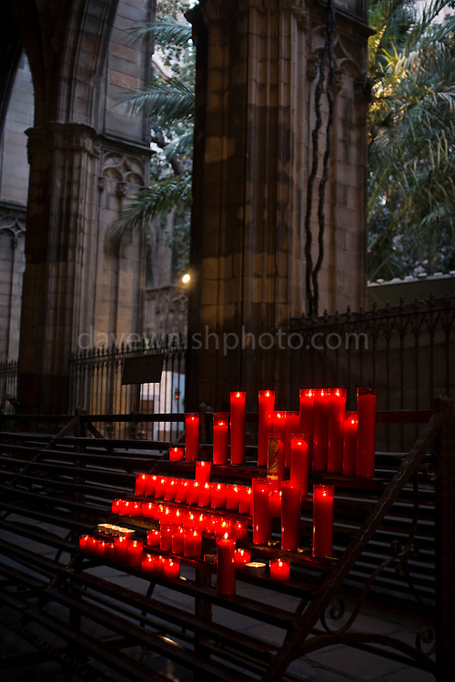 Candles in Barcelona Cathedral.  Cathedral of the Holy Cross and Saint Eulalia. Catedral de la Santa Creu i Santa Eulàlia. Catedral de la Santa Cruz y Santa Eulalia. Gothic cathedral, built between 13-15th century.