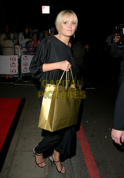 DANIELLE BRENT.Leaving the TV Quick & TV Choice Awards 2006,.The Dorchester Hotel, London, England,.September 4th 2006..full length black dress gold goody bag.Ref: AH.www.capitalpictures.com.sales@capitalpictures.com.©Adam Houghton/Capital Pictures.