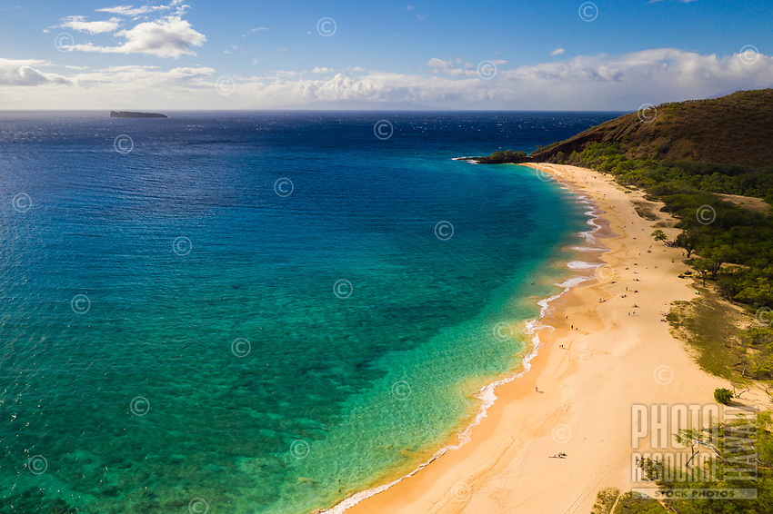 Aerial view of a clear day at Makena Beach, Maui, with Molokini Island on the distant left. Further beyond is a faintly visible Lana'i Island.