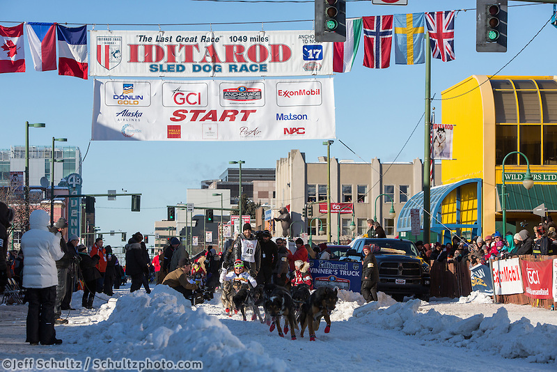 Thomas Rosenbloom and team leave the ceremonial start line with an Iditarider and handler at 4th Avenue and D street in downtown Anchorage, Alaska on Saturday March 4th during the 2017 Iditarod race. Photo © 2017 by Brendan Smith/SchultzPhoto.com.