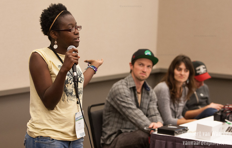 Ritza Francois speaks to a full house during the photography panel at Powershift. Over six thousand young people from all over the country are converging in Pittsburgh, PA for Power Shift 2013, a massive training dedicated to bringing about a safe planet and a just future for all people. (Photo by: Robert van Waarden)