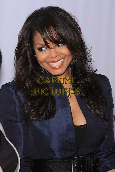 "JANET JACKSON.attending the Special New York Screening of ""Why Did I Get Married Too?"" held at the School of Visual Arts Theater, New York, NY,.March 22nd, 2010..half length waist belt smiling fringe navy blue jacket silver necklace                                                                      CAP/LNC/TOM.©LNC/Capital Pictures."