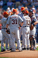 Detroit Tigers coach Omar Vizquel (13) talks with John Mayberry Jr. (64), Ian Kinsler (3), Mike Aviles (14), Casey McGehee (31), and Bryan Holaday (50) during a pitching change during a Spring Training game against the New York Yankees on March 2, 2016 at George M. Steinbrenner Field in Tampa, Florida.  New York defeated Detroit 10-9.  (Mike Janes/Four Seam Images)