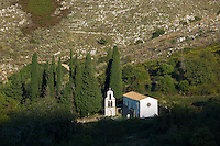 Church Saint Nikolaos Petra belfry belltower in cypresses in mountain village of Old Perithia - Palea Perithea, Corfu, , Greece