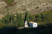 Church Saint Nikolaos Petra belfry belltower in cypresses in mountain village of Old Perithia - Palea Perithea, Corfu, , Greece