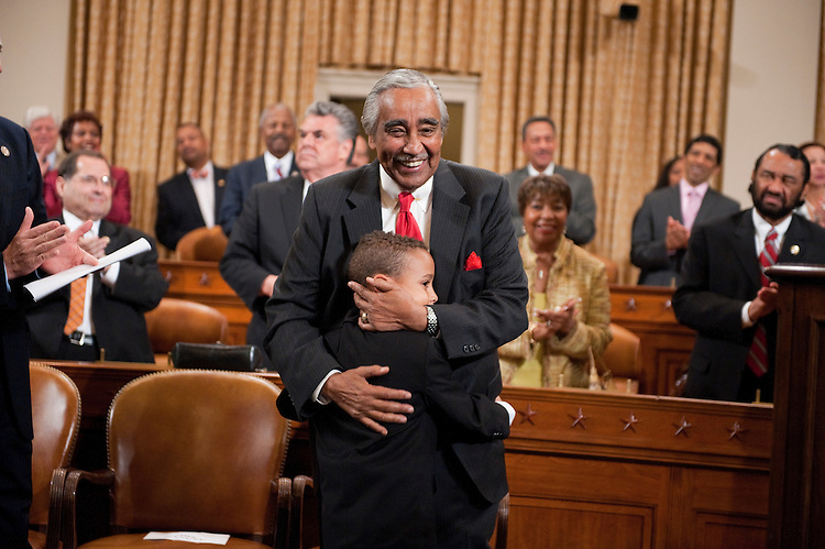 UNITED STATES - SEPTEMBER 22:  Rep. Charlie Rangel, D-N.Y., hugs his grandson in the House Ways and Means Committee hearing room in Longworth Building during a ceremony to unveil his portrait.  Rangel was chairman of the Committee from 2007-2010.  (Photo By Tom Williams/Roll Call)
