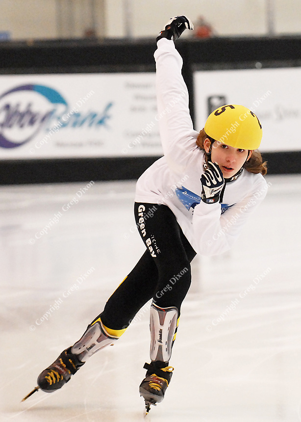 Skaters compete in short track speedskating in Badger State Winter games on Friday at Greenheck Field House in Schofield, Wisconsin