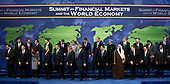 Washington, DC - November 15, 2008 -- World leaders walk off stage after a group photo at the start of the Summit on Financial Markets and the World Economy at the National Building Museum in Washington, D.C., USA, 15 November 2008. The leaders of 20 countries are in attendance. Back row, from left to right: Mario Draghi, Chairman, Financial Security Forum; Ban Ki-Moon, Secretary-General of the United Nations; Silvio Berlusconi, President of Italy; Jose Manuel Barroso, President of the European Commission; Gordon Brown, Prime Minister of the United Kingdom; Angela Merkel, Chancellor of Germany; Jose Luis Rodriguez Zapatero, President of Spain and President of the European Council; Recep Tayyip Erdogan, Prime Minister of Turkey; Dr. Manmohan Signh, Prime Minister of India; Steven Harper, Prime Minister of Canada; Kevin Rudd, Prime Minister of Australia; Taro Aso, Prime Minister of Japan; Robert Zoellick, President, World Bank Group; and Dominique Strauss-Kahn, Managing Director, International Monetary Fund (IMF).  Front row, from left to right: Jan Kees de Jager Deputy Secretary of Finance, the Netherlands; Dimitry A. Medvedev, President of Russia; Cristina Fernandez de Kirchner, President of Argentina; Felipe Calderon Hinojosa, President of Mexico; Susilo Bamgang Yudhoyono , President of Indonesia; Luiz Inacio Lula da Silva, President of Brazil; George W. Bush, President of the United States; Hu Jintao, President of China; Abdullah bin Abd al-Aziz Al Saud, King of Saudi Arabia; Nicolas Sarkozy, President of France; Lee Myung-bak, President of the Republic of Korea; and Kgalema Motlanthe, President of South Africa..Credit: Matthew Cavanaugh - Pool via CNP