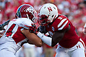 10 Sept 2011: Jason Ankrah #9 of the Nebraska Cornhuskers against Ryan Skidmore #84 of the Fresno State Bulldogs at Memorial Stadium in Lincoln, Nebraska. Nebraska defeated Fresno State 42 to 29.