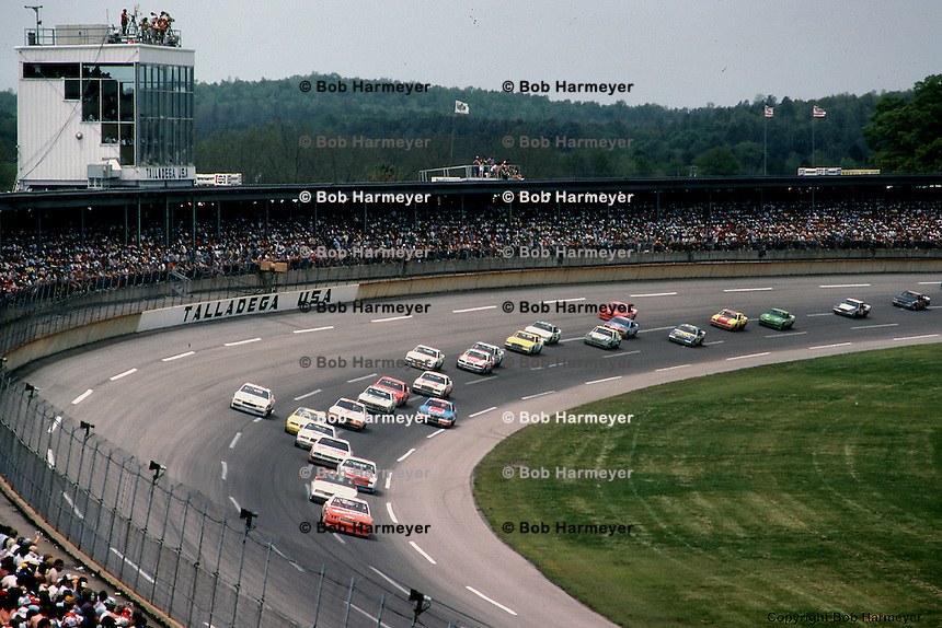 Cale Yarborough leads a group of cars during a 1983 NASCAR race at Talladega, Alabama.