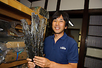 Suita Hiroyuki, CEO of Suita Shoten kombu shop, holding some kombu, Tsukiji, Tokyo, Japan, July 23, 2009. Suita Shoten sells five kinds of kombu, including top quality ma-kombu from the coast near Hakodate in Hokkaido.