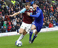 Burnley's Phillip Bardsley holds off the challenge from Leicester City's Ben Chilwell<br /> <br /> Photographer Rich Linley/CameraSport<br /> <br /> The Premier League - Burnley v Leicester City - Saturday 16th March 2019 - Turf Moor - Burnley<br /> <br /> World Copyright © 2019 CameraSport. All rights reserved. 43 Linden Ave. Countesthorpe. Leicester. England. LE8 5PG - Tel: +44 (0) 116 277 4147 - admin@camerasport.com - www.camerasport.com