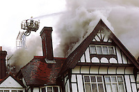 Firefighters attacking a fire in a hotel. They are using a hydraulic platform to tower over the fire and direct water through the roof into the main seat of the fire. The ground crews are using main jets to try and stop the fire spreading whilst other firefighters are entering the fire wearing breathing apparatus...© SHOUT. THIS PICTURE MUST ONLY BE USED TO ILLUSTRATE THE EMERGENCY SERVICES IN A POSITIVE MANNER. CONTACT JOHN CALLAN. Exact date unknown.john@shoutpictures.com.www.shoutpictures.com.