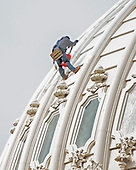 A construction worker paints the exterior of the United States Capitol dome in Washington, DC on Saturday, October 6, 2018. <br /> Credit: Ron Sachs / CNP