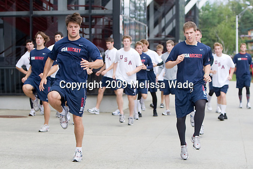 Zach Budish (US - 24), Matt Donovan (US - 7) - Team USA warms up outside the rinks prior to their second game against Team Russia during the 2009 USA Hockey National Junior Evaluation Camp on Wednesday, August 12, 2009, in the USA (NHL-sized) Rink in Lake Placid, New York.