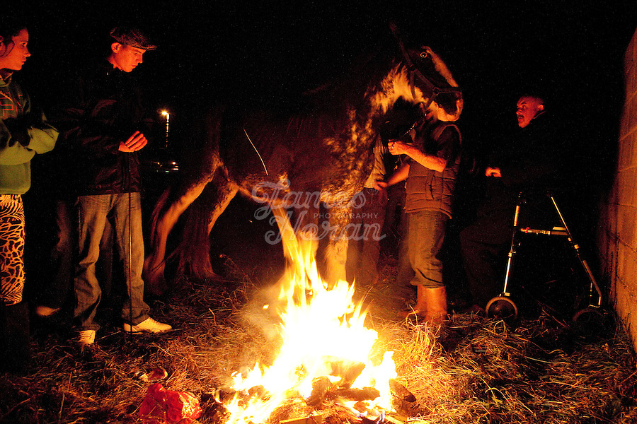 2/10/2010.  Horse traders from Dublin gather around the camp fire at the Ballinasloe Horse Fair, Ballinasloe, County Galway, Ireland. Picture James Horan