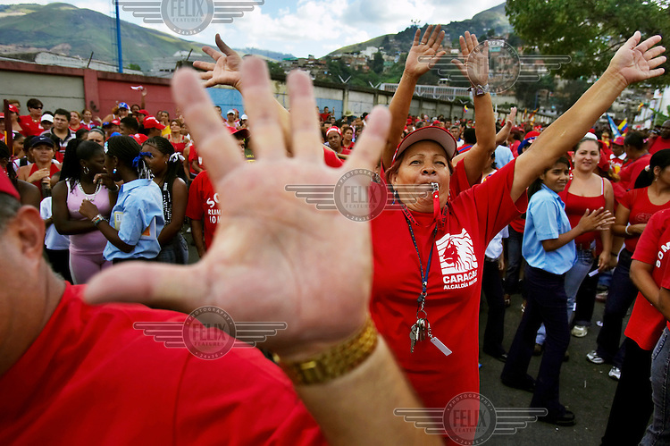 Supporters of president Hugo Chavez cheer at a rally during the election campaign.