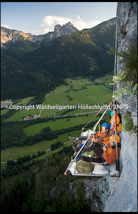 BNPS.co.uk (01202 558833)<br /> Picture: Waldseilgarten-H&ouml;llschlucht<br /> <br /> **please byline Waldseilgarten-H&ouml;llschlucht/BNPS**<br /> <br /> Forget cramped holiday parks, claustrophobic tents and screaming kids - campers craving the ultimate peace and quiet can now find it 500ft up a sheer mountain face. The terrifyingly high mountains of the German Alps are home to the world's most extreme form of camping - and you don't need any climbing experience to enjoy it. Accommodation comes in the form of a 'portaledge' - an incredibly strong frame covered in canvas, secured to the cliff face using strong climbing ropes and shackles. Campers have to scale the mountain to get to their bed for the night - and can only bring with them the bare essentials of a sleeping bag, a rope and a basic dinner. But the ultimate buzz comes at a price however at &pound;750 per night.