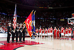 The Color Guard presents the flags during the National Anthem prior to the Wisconsin Badgers Big Ten Conference NCAA college basketball game against the Illinois Fighting Illini on Sunday, March 4, 2012 in Madison, Wisconsin. The Badgers won 70-56. (Photo by David Stluka)