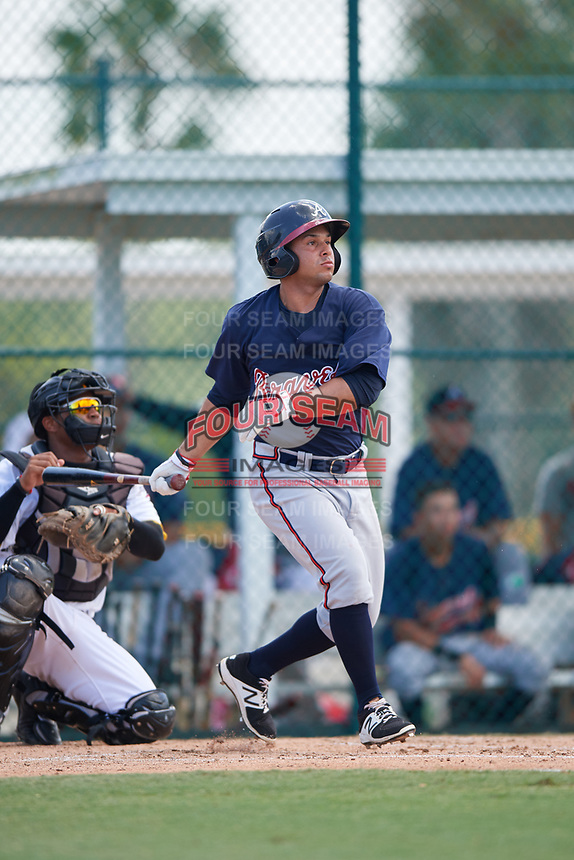 GCL Braves center fielder Carlos Baerga (64) hits a single and drives in a run during a game against the GCL Pirates on July 26, 2017 at Pirate City in Bradenton, Florida.  GCL Braves defeated the GCL Pirates 12-5.  (Mike Janes/Four Seam Images)