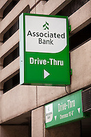 An Associated Bank drive-Thru ATM is seen in Milwaukee, Wisconsin, Wednesday June 26, 2013. Associated Banc-Corp is a regional bank holding company providing retail and commercial banking, commercial real estate lending, wealth management and specialized financial services.