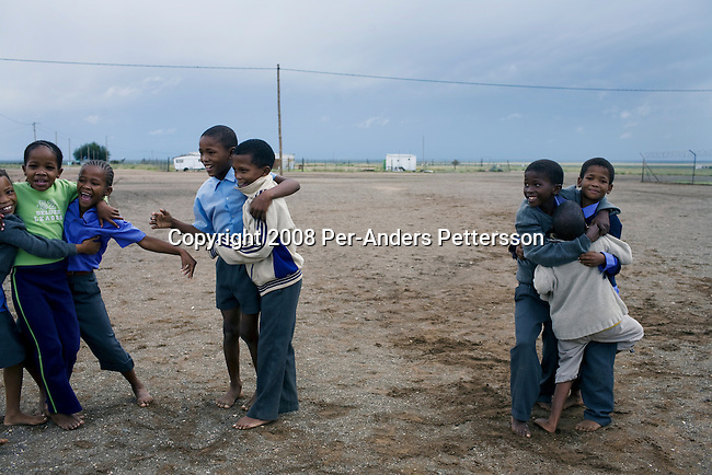 KOICHAS, NAMIBIA APRIL 2: Children play during a break in a rural farm school on April 2, 2008 outside Koichas, Namibia. About 300 children from nearby farms and as long as from Windhoek and Northern Namibia attend the boarding school. (Photo by Per-Anders Pettersson/Getty Images)...