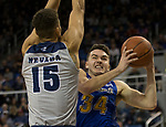 South Dakota State guard Alex Arians (34) attempts  to shoot over Nevada' Trey Porter (15) in the second half of an NCAA college basketball game in Reno, Nev., Saturday, Dec. 15, 2018. (AP Photo/Tom R. Smedes)