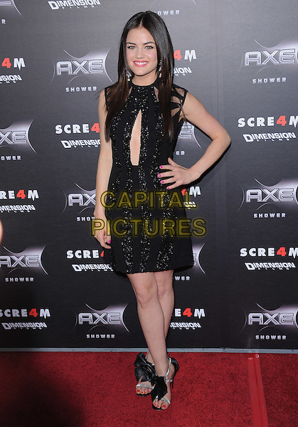 LUCY HALE .at the Weinstein World Premiere of 'Scream 4' held at The Grauman's Chinese Theatre in Hollywood, California, USa, April 11th 2011..full length hand on hip shoes sandals bow bows open toe black cut out beaded sparkly  sequined sequin sleeveless dress .CAP/RKE/DVS.©DVS/RockinExposures/Capital Pictures.