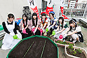 Maids pose for the cameras during the ''Akihabara Vegetable Garden Project'' at the Japan Agricultural Newspaper building in Akihabara on June 15, 2016, Tokyo, Japan. The annual event organised by NPO group Licolita sees maids and volunteers from local cafes and stores joining the Akihabara Vegetable Garden Project. This year 7 Akihabara maids planted habanero, peppermint, bhut jolokia and coriander. (Photo by Rodrigo Reyes Marin/AFLO)
