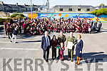 Members of the Defence Forces Lt Denis Sheahan and Gunner Mark Coffey presents the  tricolour and Proclamation to the youngest and Oldest pupils Patrick Brian Daly and Ciara Sugrue  of Moyderwell Primary to commemorate the 100 year anniversary here with Chairman Board of Management Cllr Jim Finucane, Principal Moire Quinlan, Pupils and Staff on Tuesday