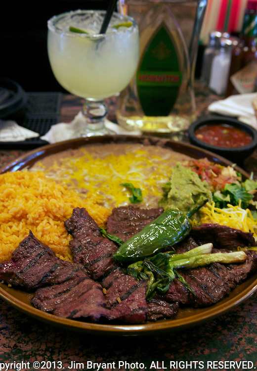 Carne Asada, beef, Mexican Rice, refried beans, salsa, onions, green pepper and margarita.  ©2013. Jim Bryant Photo. ALL RIGHTS RESERVED.