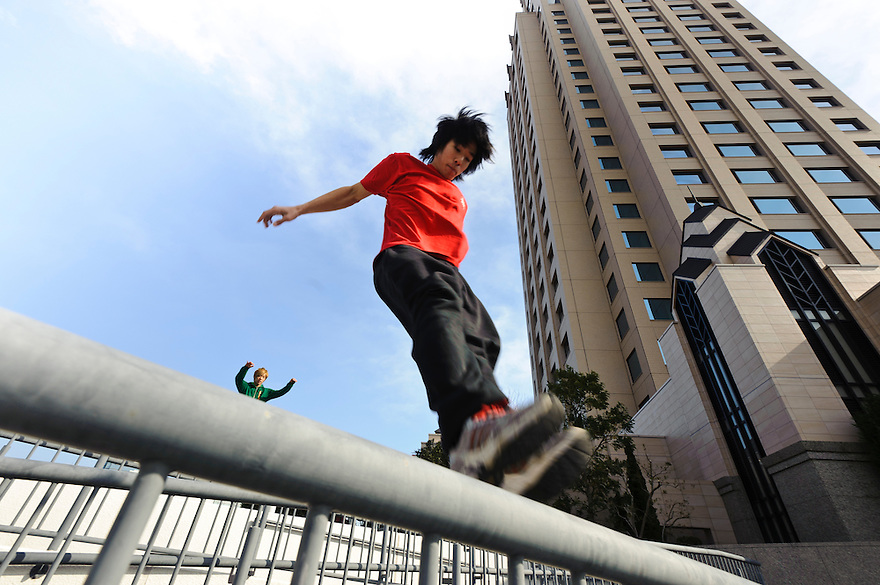 "(L to R) Traceurs (parkour practitioners) ""Zen"" and ""Yutaro"". Practicing Parkour in Odaiba, Tokyo, Japan, January 27, 2012. Parkour is a modern method of physical training, also known as freerunning. It was founded in France in the 1990s. There is a small group of around 50 parkour practitioners in Tokyo."